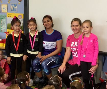 Race for life and cancer research medals brought in by Megan, Zeta and Nadia's mums.